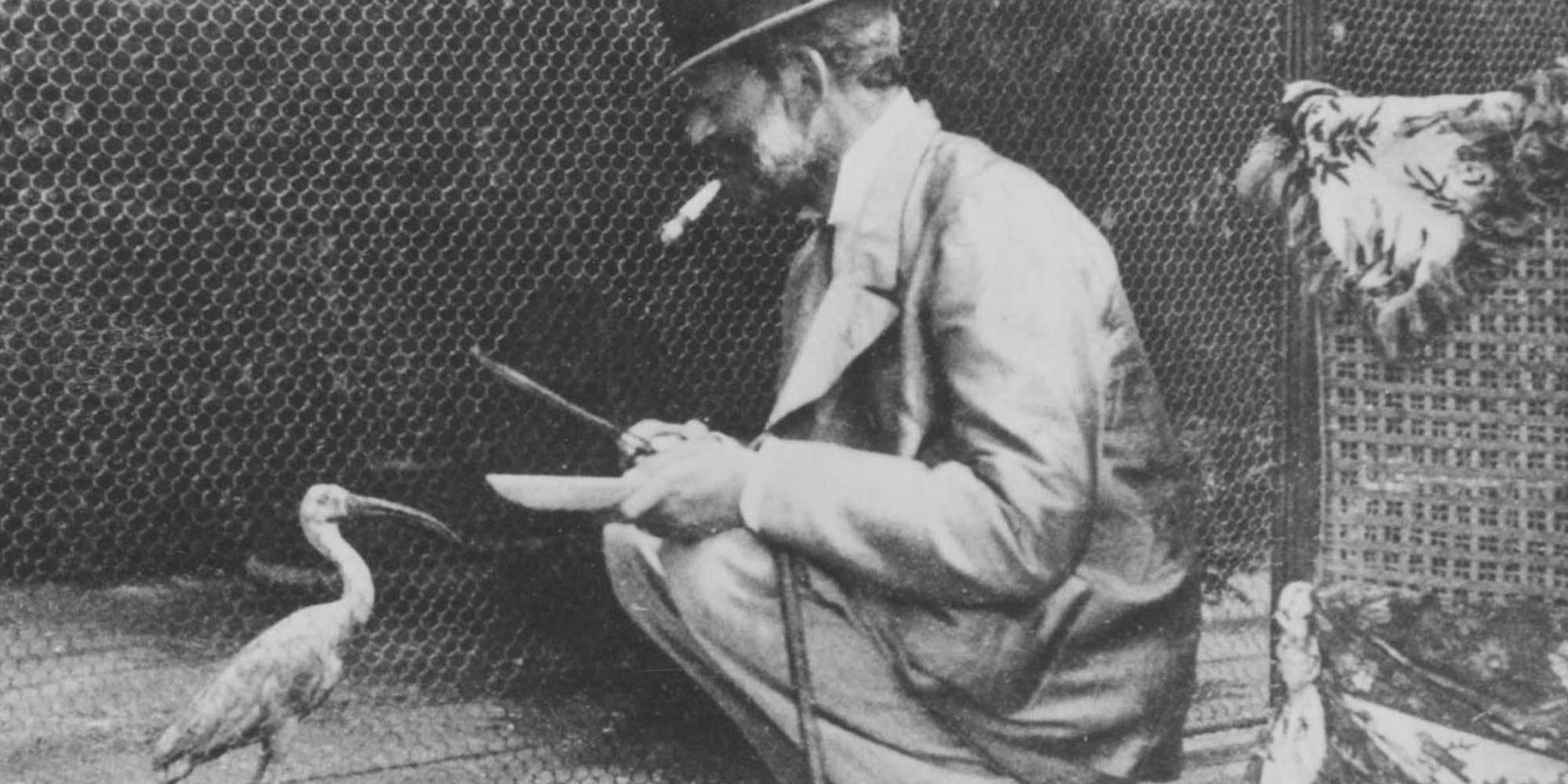 Baron Ferdinand feeding a bird at the aviary
