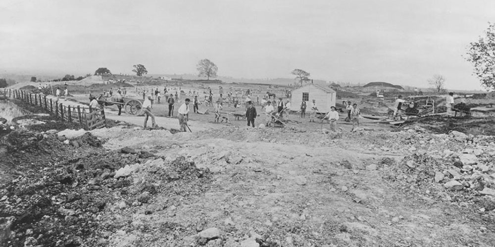 Men beginning the construction of the Manor