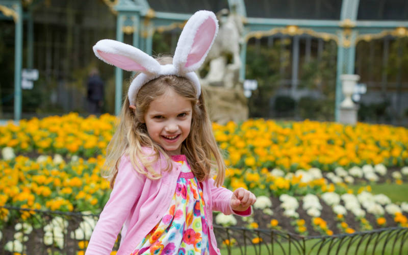 Girl with bunny ears enjoying Cadbury Egg Hunt at Waddesdon Manor