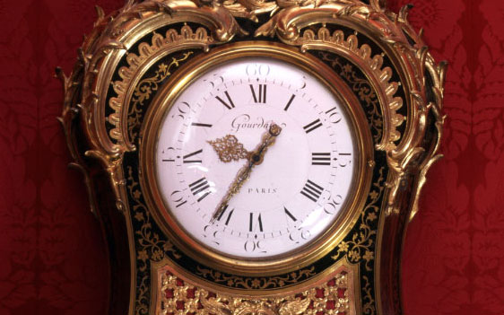 A cartel clock of serpentine form