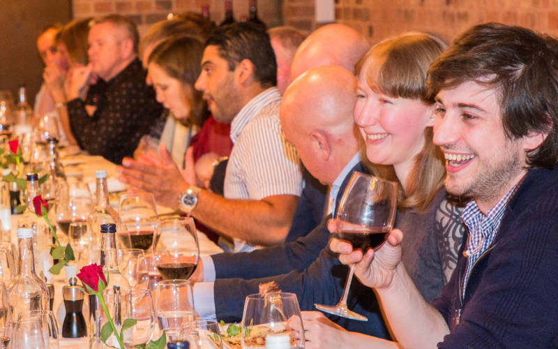People enjoying a wine event in the cellars