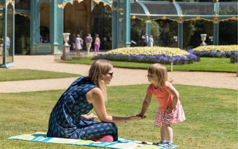 Mother and daughter on the lawn in front of the Aviary