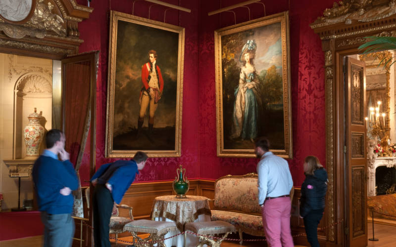 Visitors enjoying the Red Drawing Room