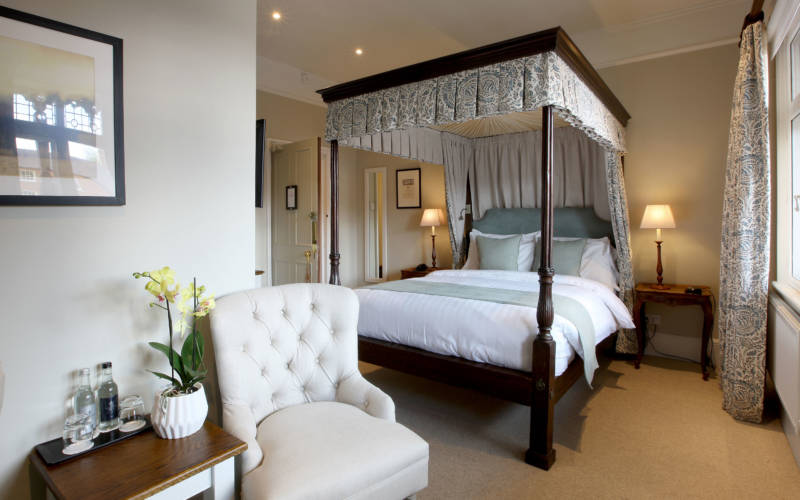 A four poster bed in the Five Arrows Hotel