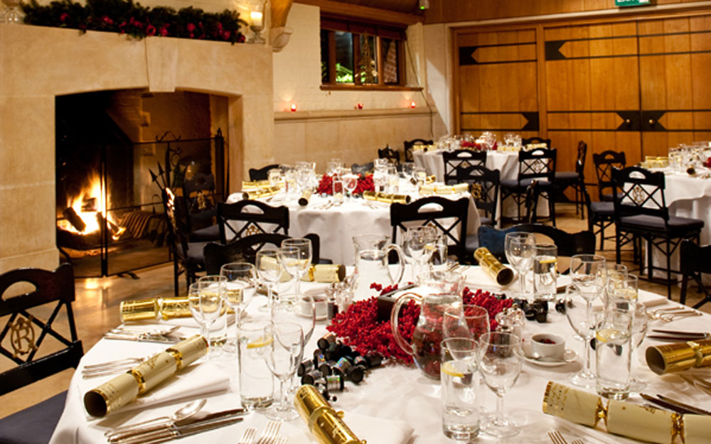 Circular tables decorated for Christmas dinner