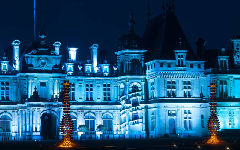 Waddesdon Manor North Front illuminated in blue