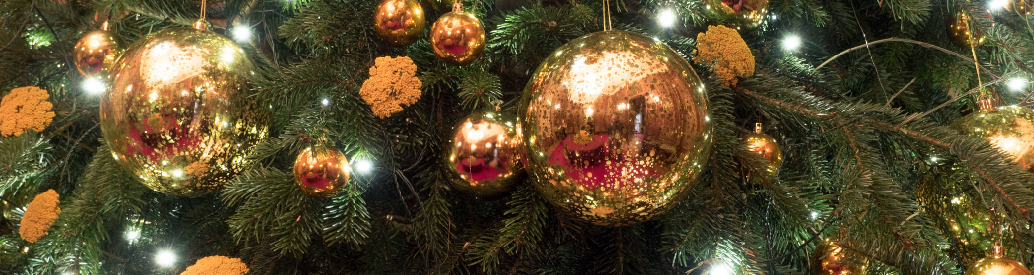 Gold Baubles on a christmas tree