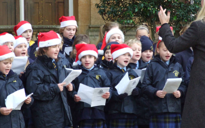 Beachborough School singing Christmas carols in front of the house