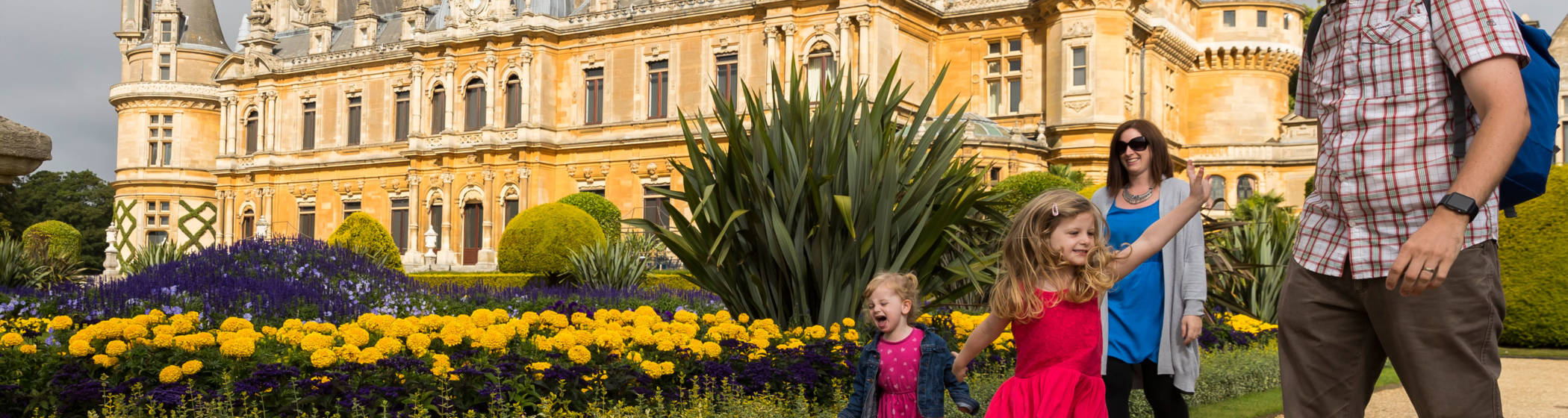 Family walking round the South front Parterre