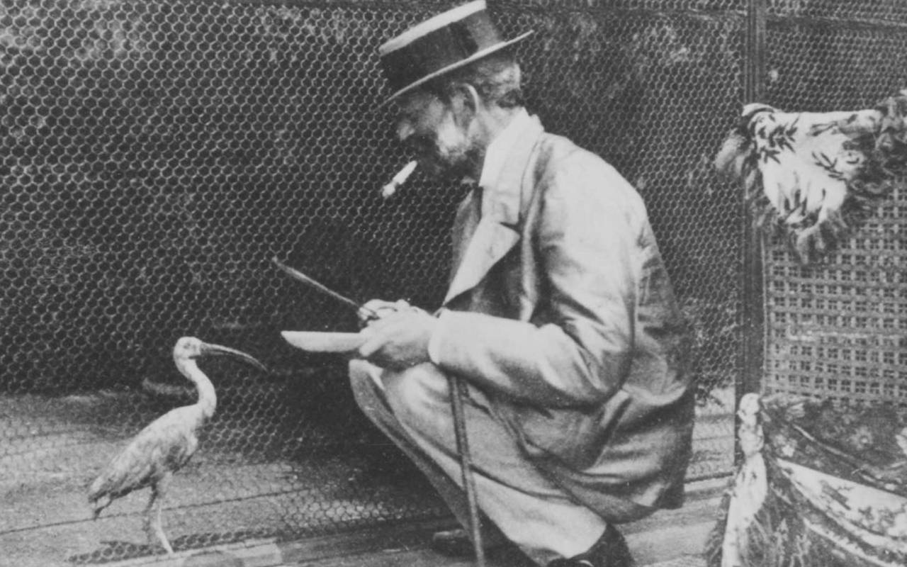 Baron Ferdinand feeding a bird at the Aviary