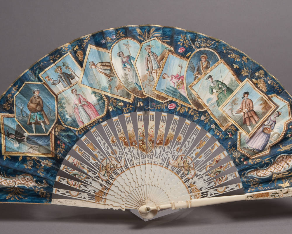 Fan with ivory mount, pierced, carved and engraved, and in part painted with applied gold.