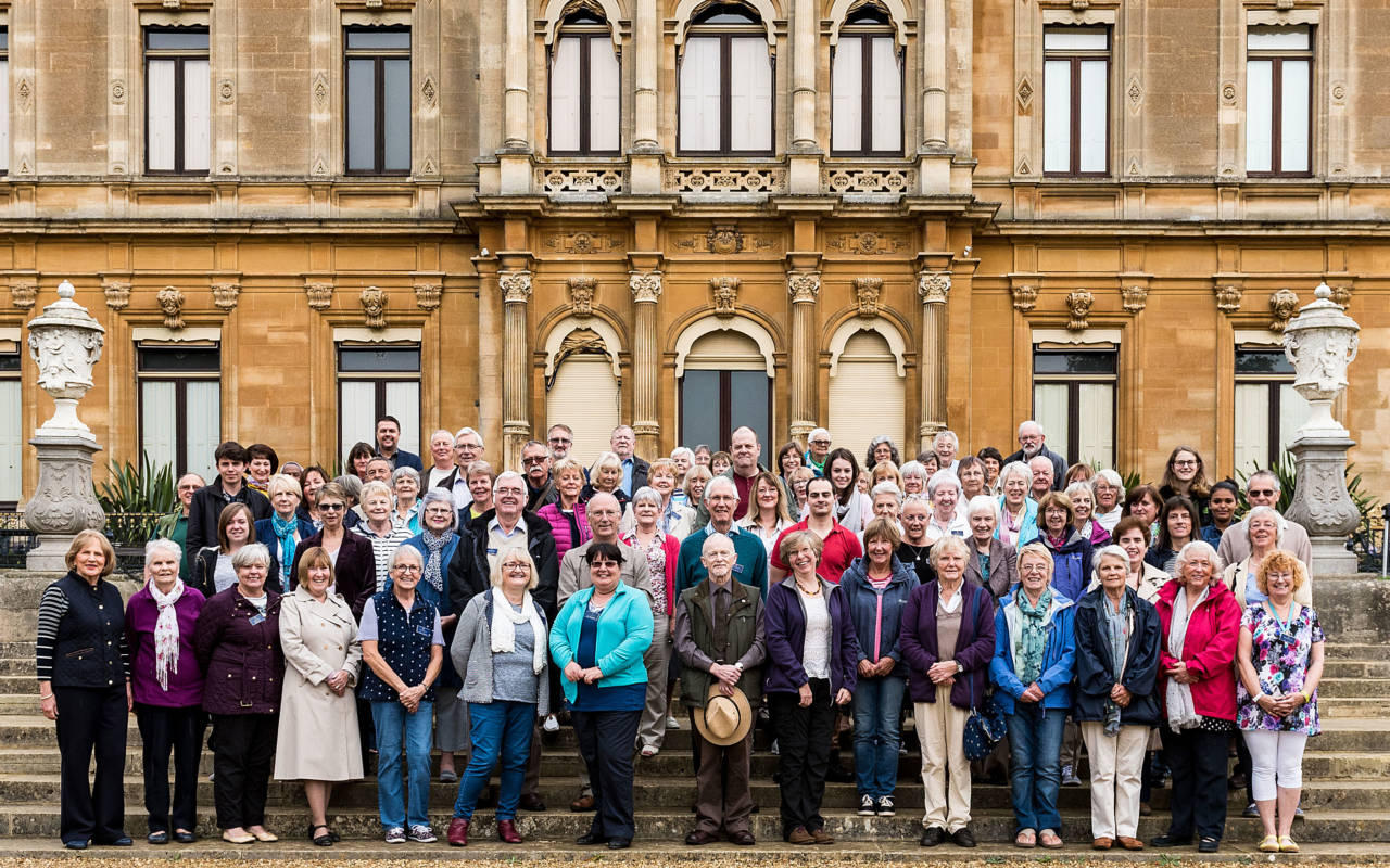 Group of volunteers standing in front of Waddesdon Manor
