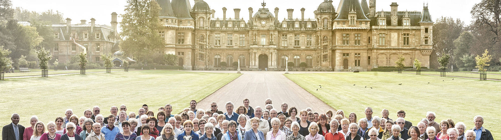 Group of volunteers standing in front of Waddesdon Manor north front