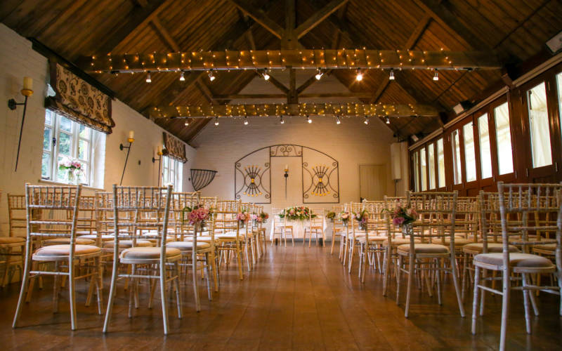 chairs set up for a wedding in Old Coach House