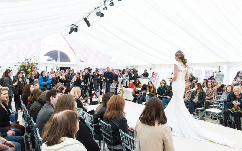 Bride facing the crowd on catwalk at Waddesdon Wedding