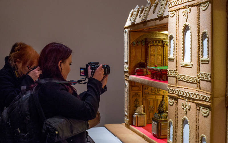 Photographers infront of Biscuiteers model of waddesdon manor