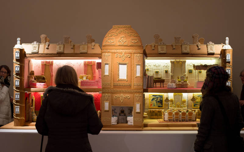 Visitors admiring Waddesdon Manor recreated in gingerbread