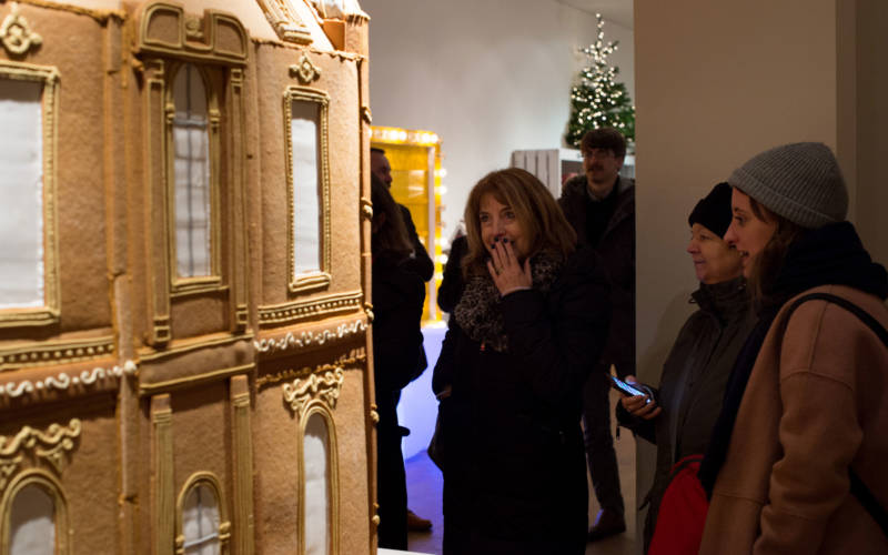 Visitor admiring Biscuiteers Waddesdon gingerbread model