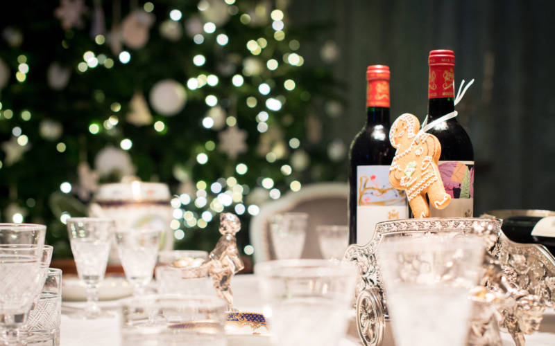 Gingerbread man attached to wine bottle