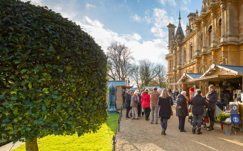 visitors walking around the christmas fair