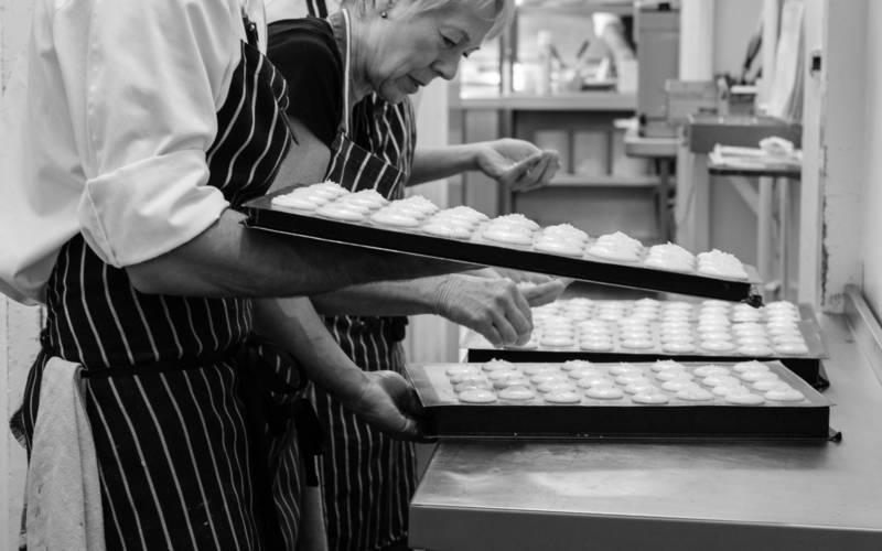 Chefs cooking pies in kitchen