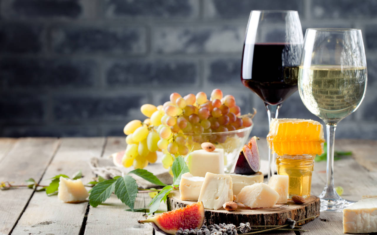 A selection of cheese and wine laid out on a table