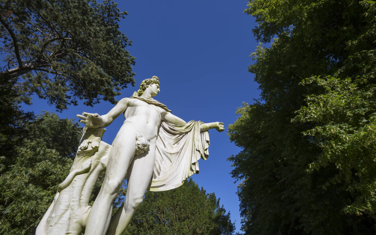 White sculpture of Apollo from below