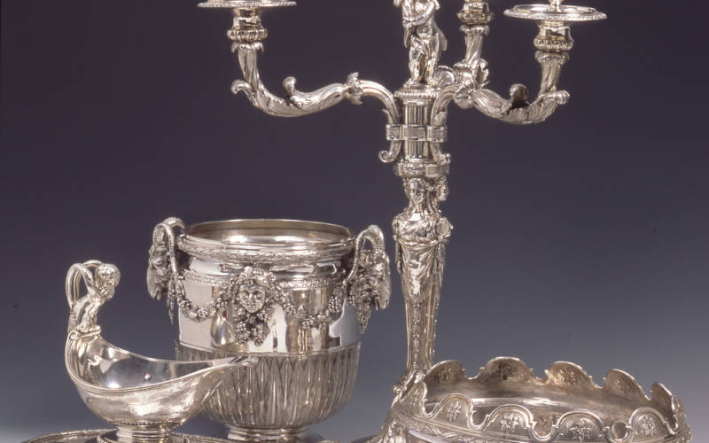 Silver serving dishes and candelabra