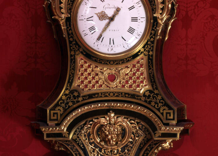 A cartel clock of serpentine form