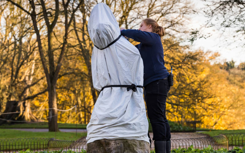 Statues being wrapped against the cold weather
