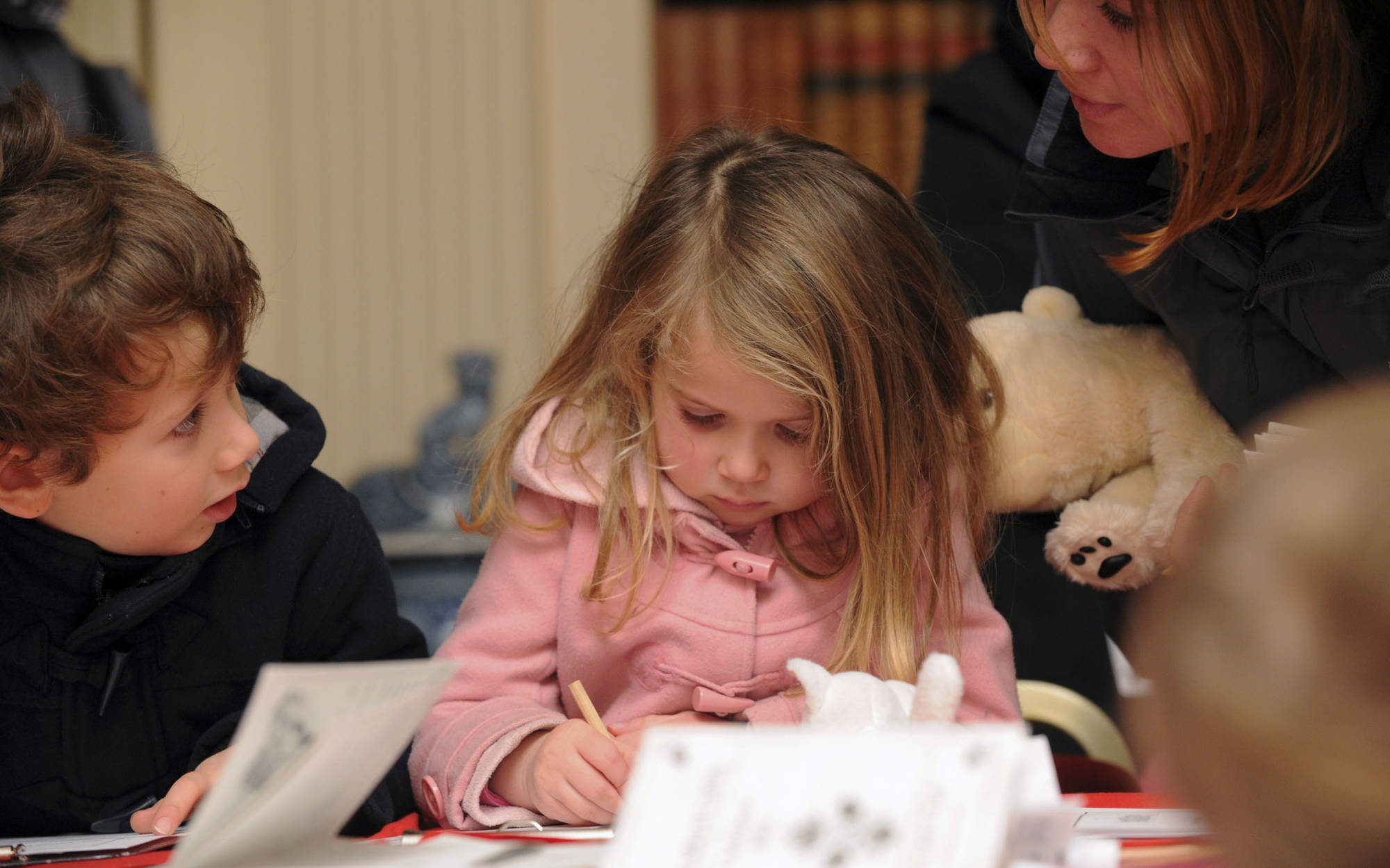 small child writing a letter to father christmas