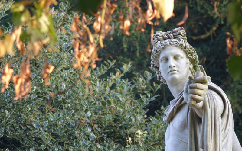 historic statue in the grounds in autumn