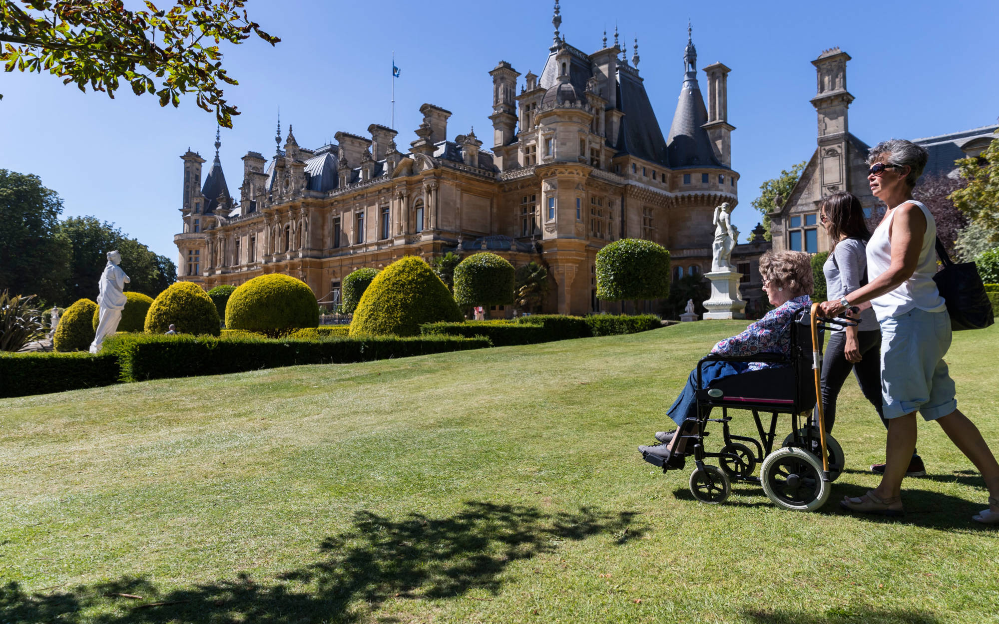 Visitor in a wheelchair on the south lawns