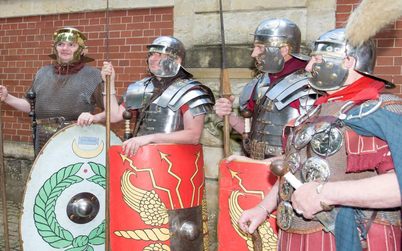 Group of reenactors dressed as Roman Soldiers
