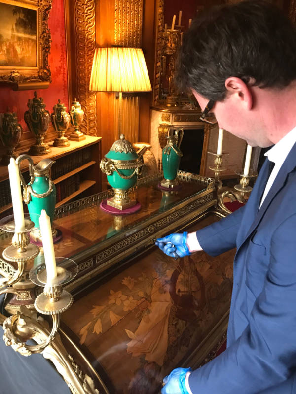 Here Michael demonstrates the locking mechanism on Riesener's roll-top 19th century desk.