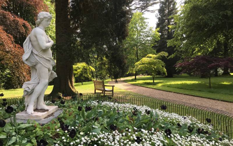Half moon path in the gardens with statue