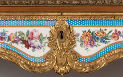 Rectangular fall-front desk made by Martin Carlin with gilt-bronze mounts and ten Sèvres plaques with turquoise borders and baskets of flowers, c. 1775