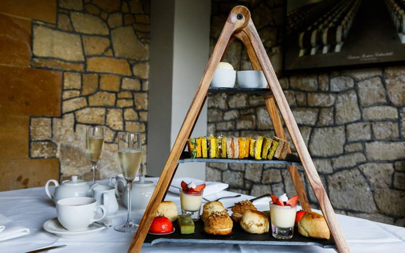 Afternoon tea on a wooden stand