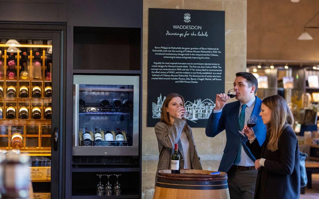 Gentleman and ladies trying wine