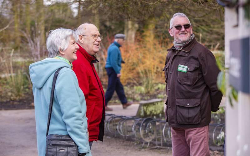 Volunteer speaking with visitors at Dunham Massey, Cheshire