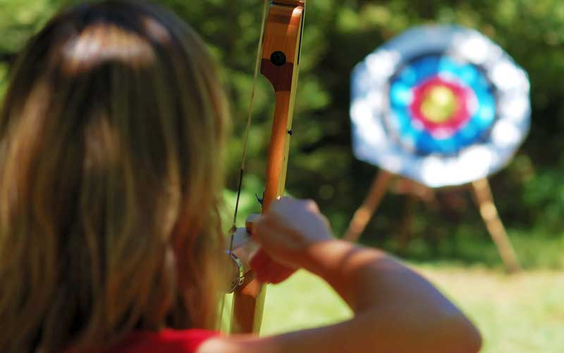 Girl aiming at an archery target