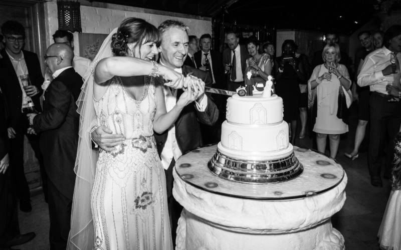 Weddings-dairy-cake-cutting-david-bostock-3000x1875