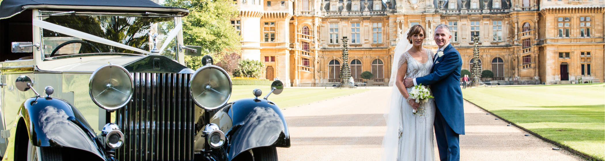 A couple pose in the driveway of Waddesdon Manor