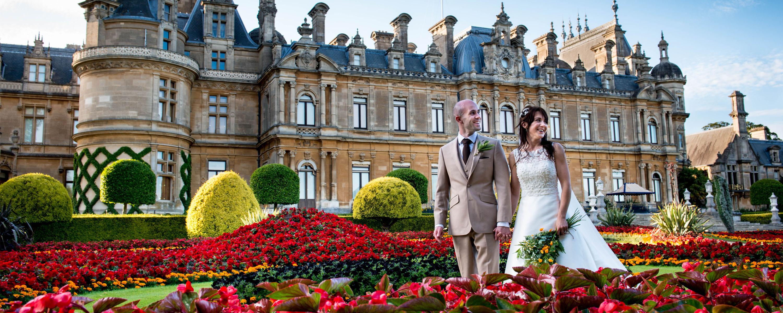 Wedding couple outside of Waddesdon Manor's colourful Parterre garden