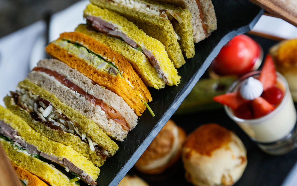 Dainty sandwiches and pastries for an afternoon tea