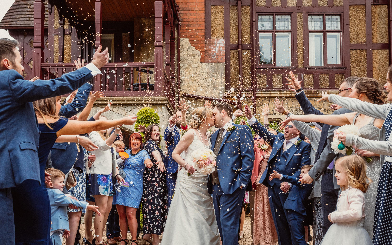 Wedding party throwing confetti